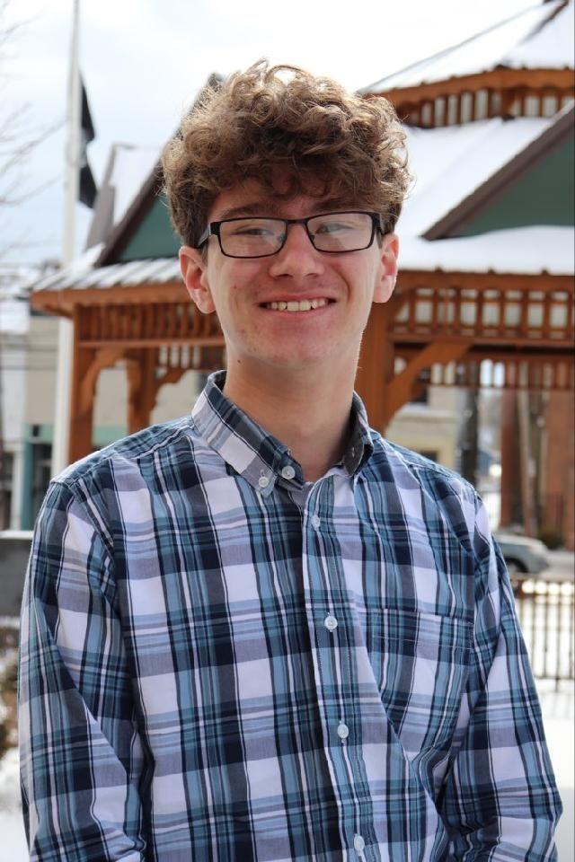male award winner smiling
