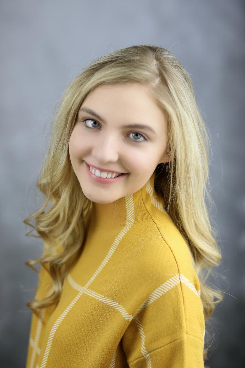 female winner smiling in professional headshot