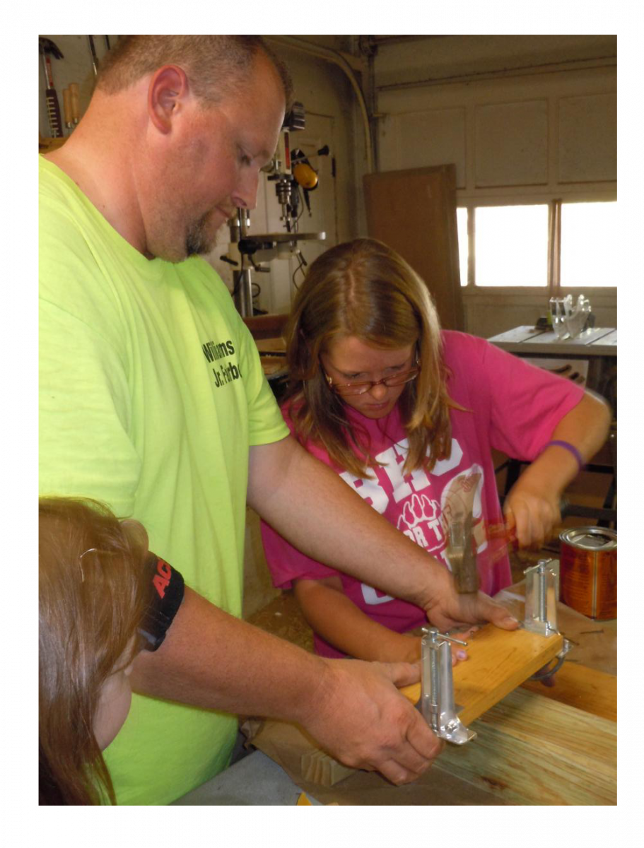Jamie helps young 4-Hers with their first woodworking project.