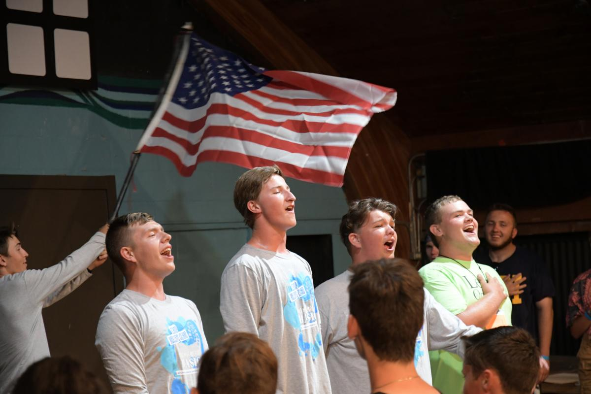 OMK camp counselors enjoy a moment to sing in front of their campers at Camp Kelleys Island.