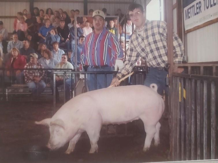 Keeran with a market hog at the Fairfield County Fair.