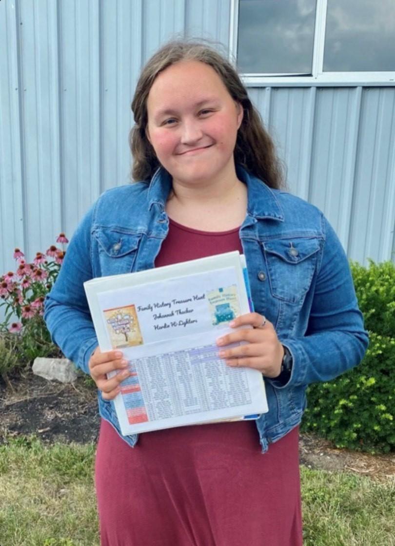 A girl holding a folder.