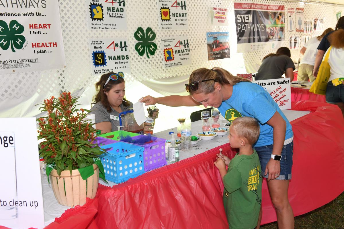 A 4-H member leading a STEM activity at the 2019 Farm Science Review.