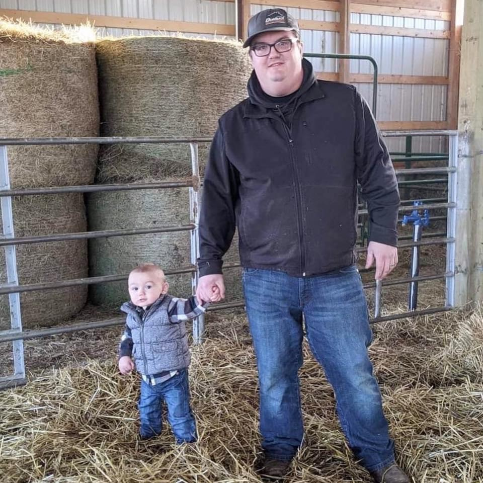 Keeran and his son on the family farm.