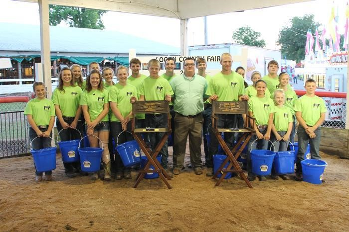 Keeran with a group of participants at a cattle show in Logan County.
