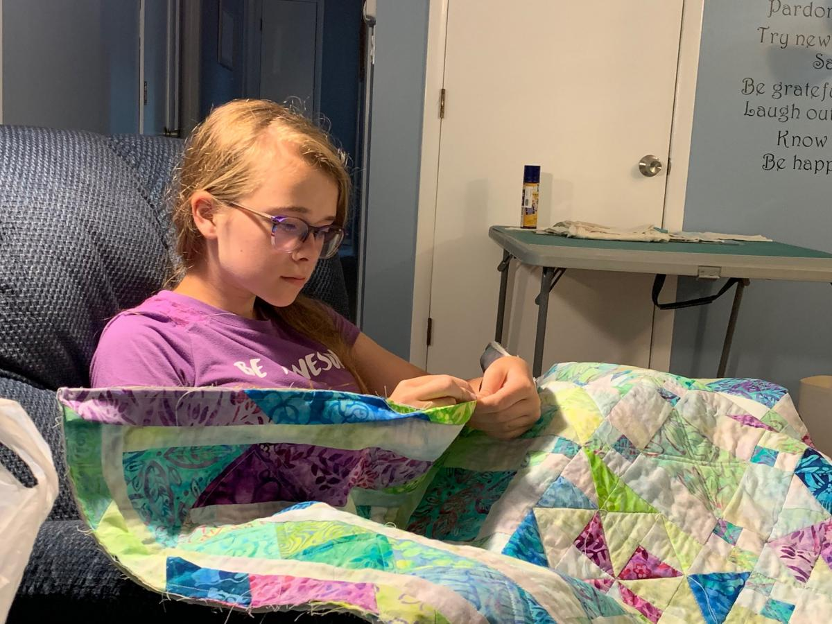 Allie working on her quilt.