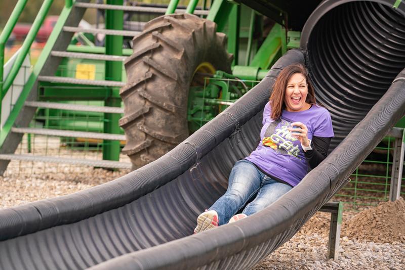 A woman on a combine slide.