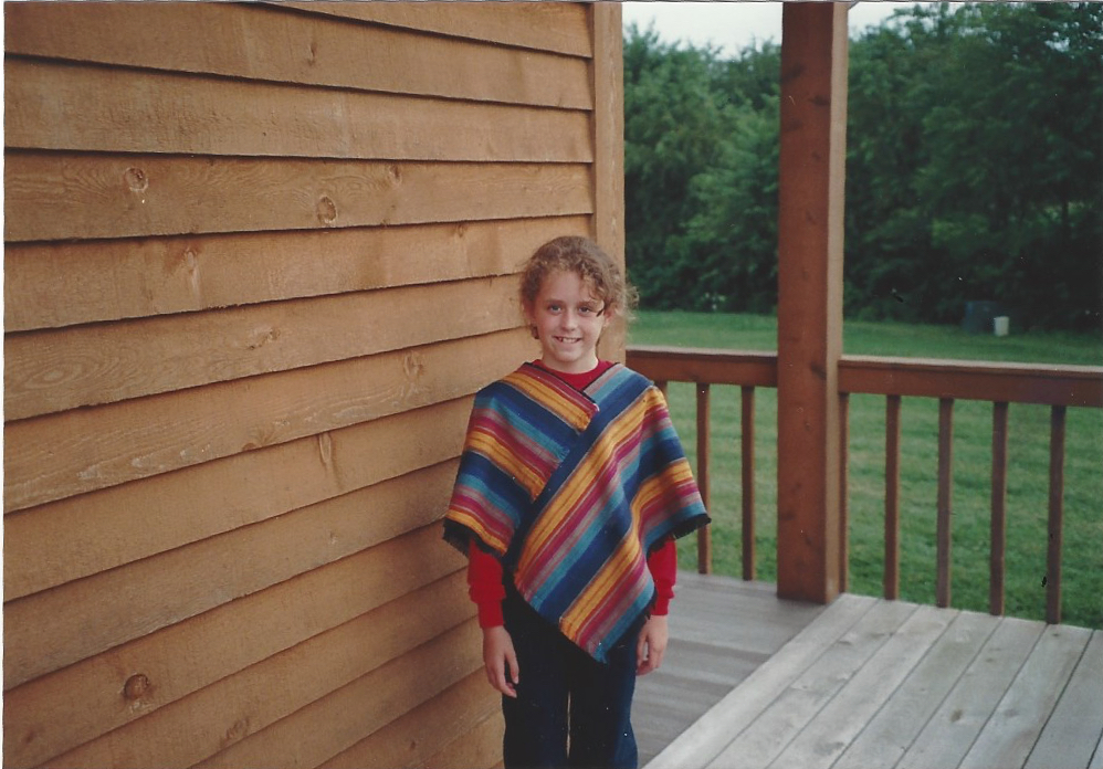 Crystal in a poncho she made during a sewing project.
