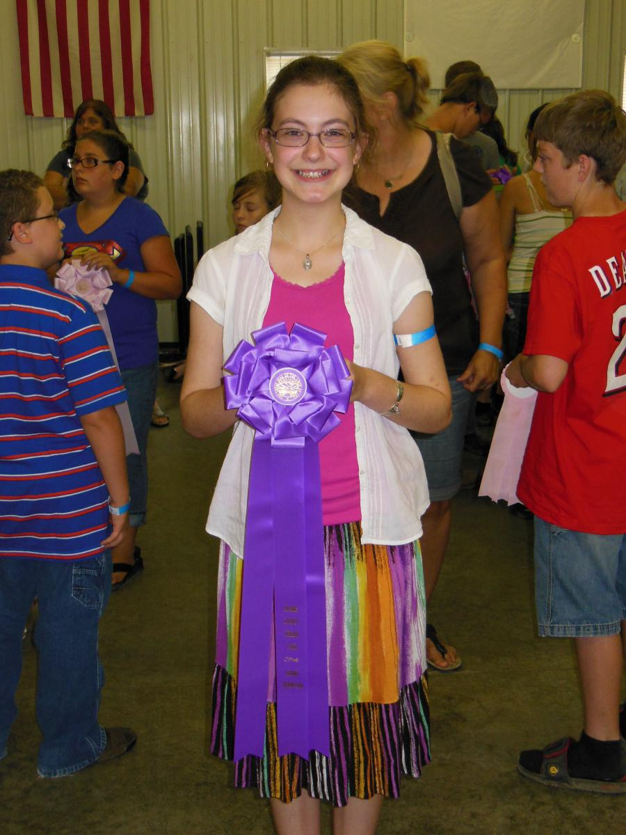 India with her grand champion rosette.