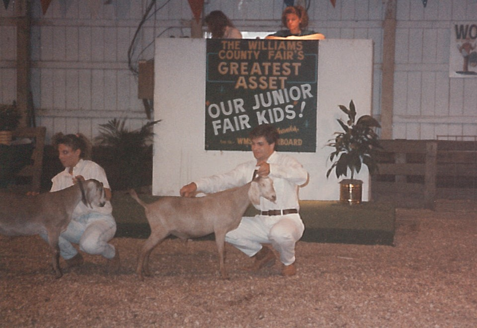 Kirk showing a dairy goat at the Williams County Fair.