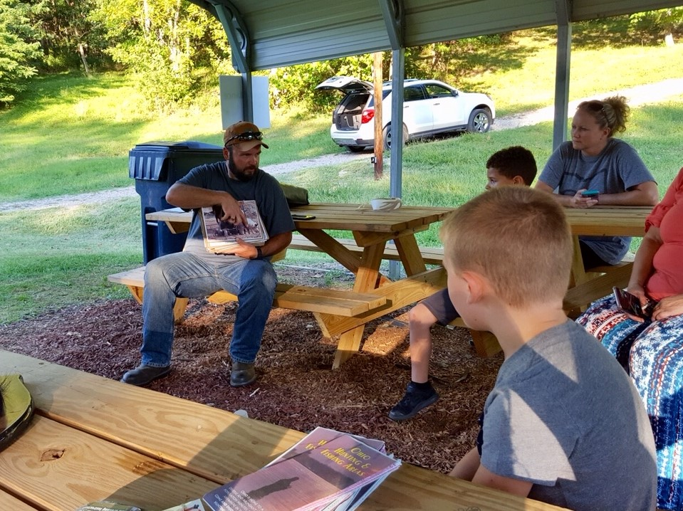 Eric Clary leading a natural resources activity with a 4-H group.