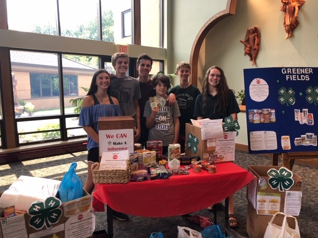 Members of the Greener Fields 4-H Club collecting canned goods and money to benefit the Geauga County Hunger Task Force.