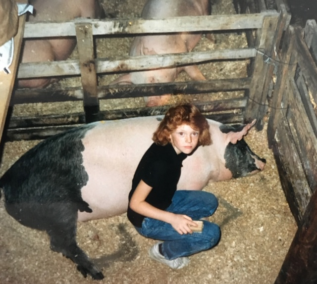 Young Tara with her pig.