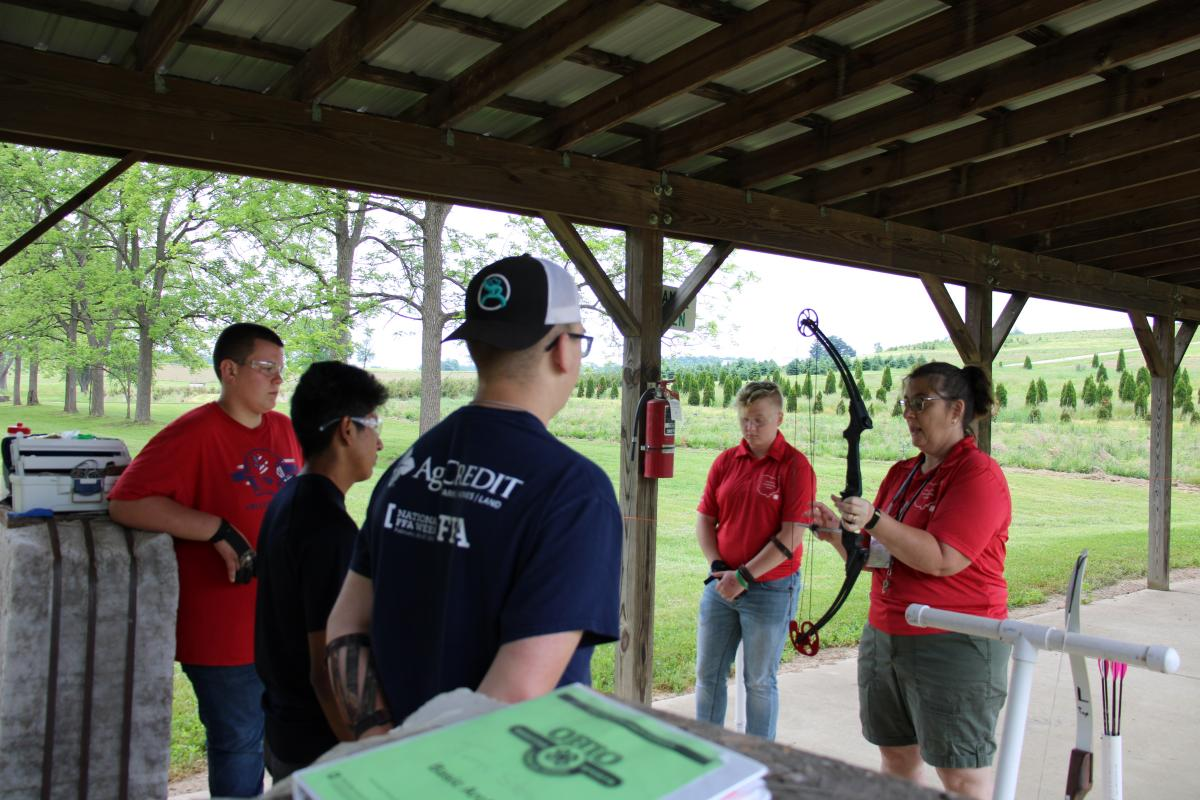 Campers preparing for an archery session at camp.