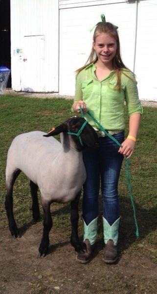 Emma with a market lamb.