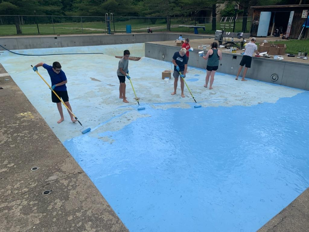 A group of people painting the pool at Canter's Cave.
