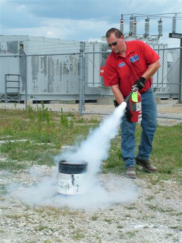 Jamie demonstrating the proper use of a fire extinguisher. Jamie does many trainings for 4-Hers.