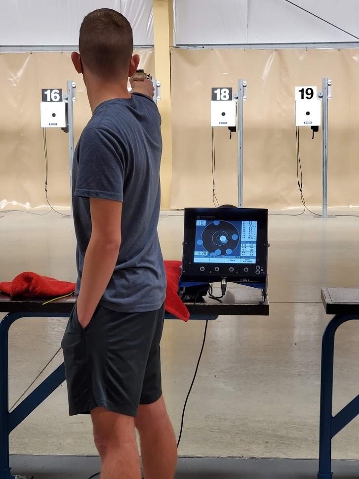 Johnathon Dorsten aiming an air pistol.