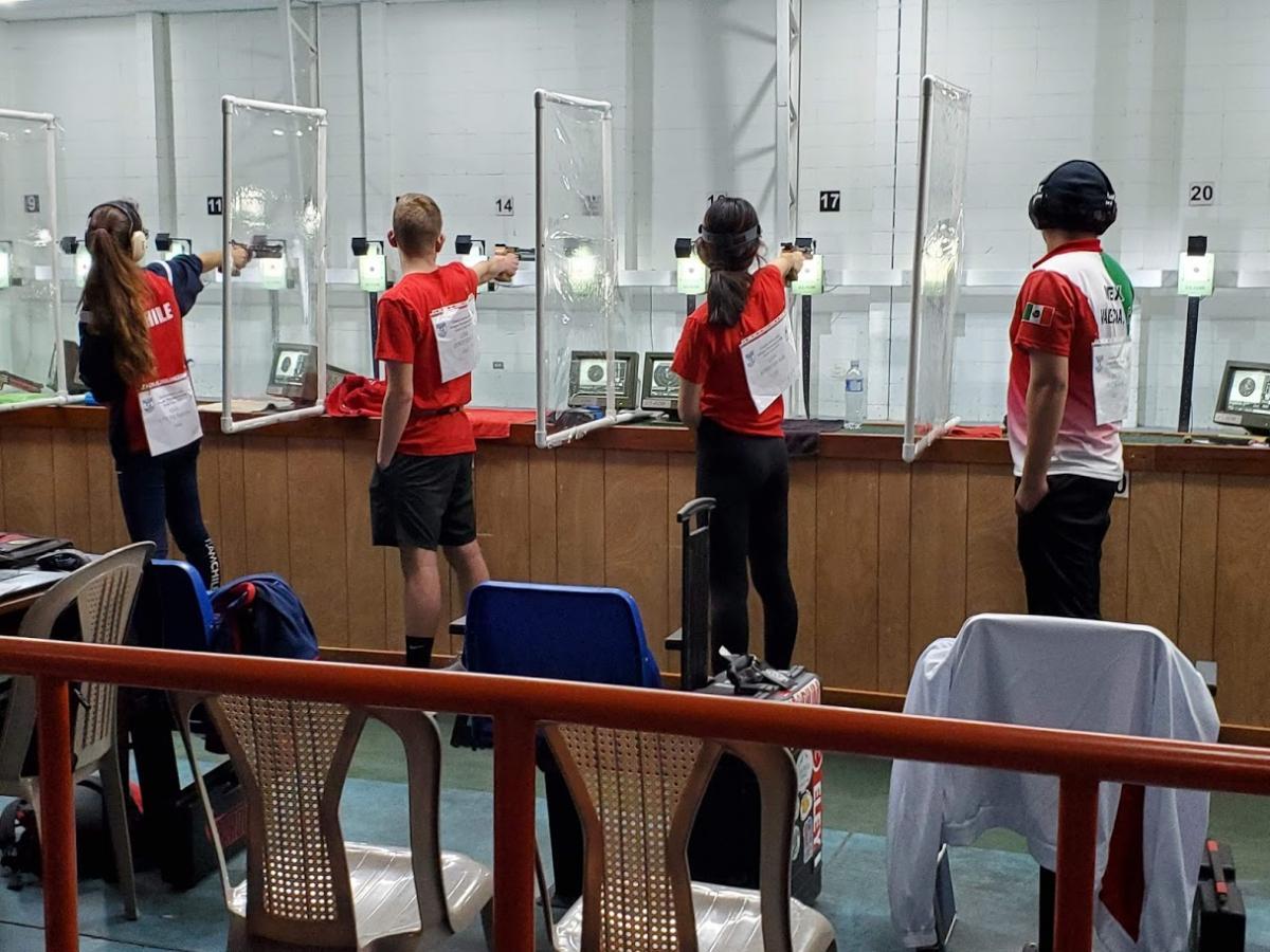 4 people shooting at targets.