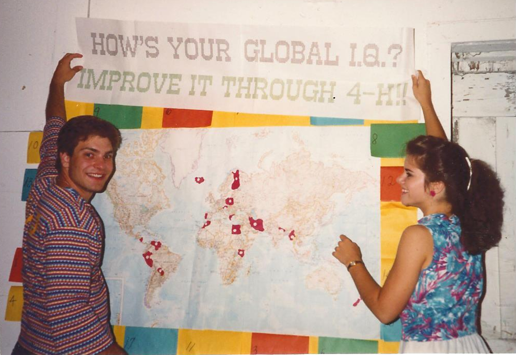 "Kirk with a map tiled ""How's Your Global IQ? Improve it through 4-H!"""