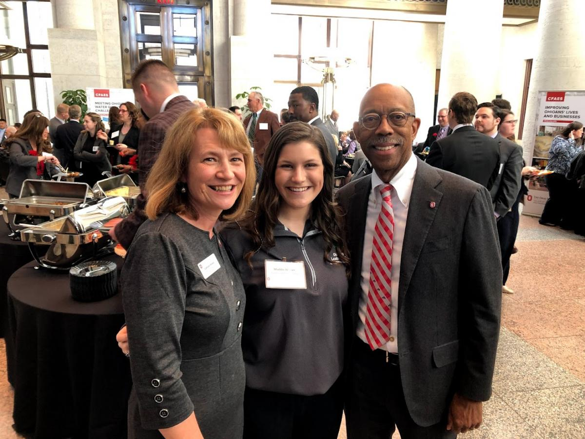 Maddie with Dean for the College of Food, Agricultural, and Environmental Sciences Cathann A. Kress and past University President Dr. Michael V. Drake.