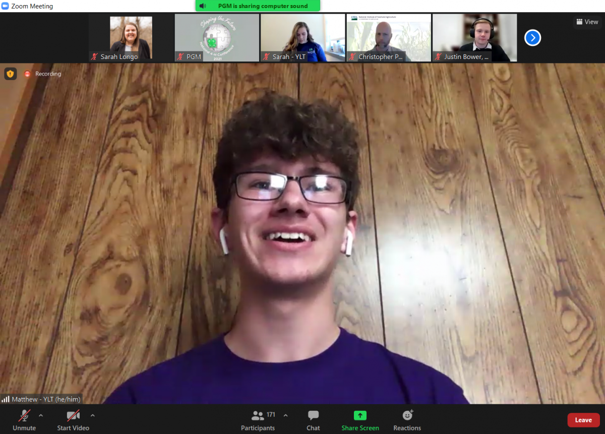 A young man speaking on Zoom.