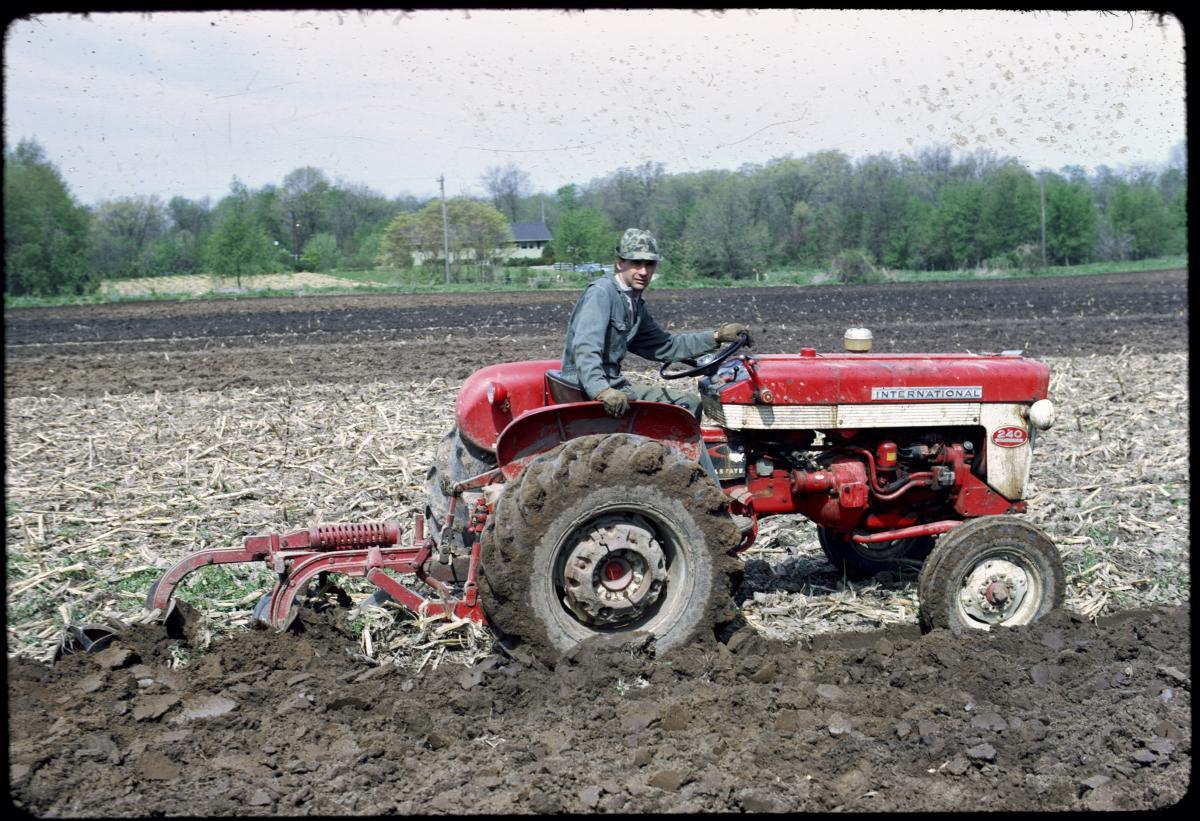 Howard preparing the field to plant 4-H strawberries