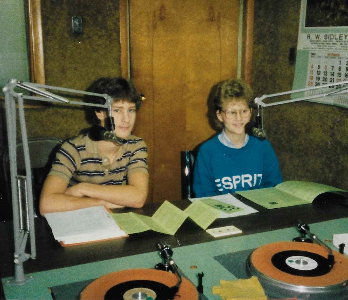 Lisa (right) and another 4-H member participating in a radio interview for 4-H.