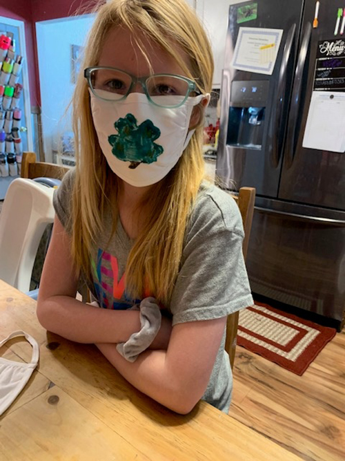 A girl wearing a face mask.