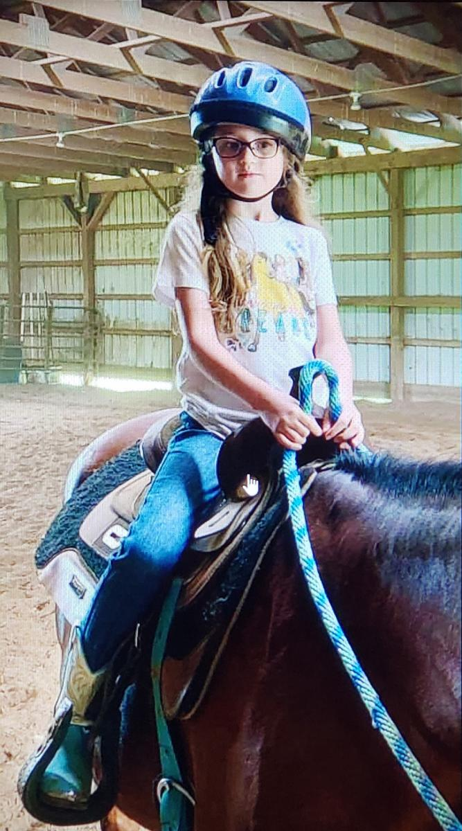 Madelynn Hicks horseback riding.