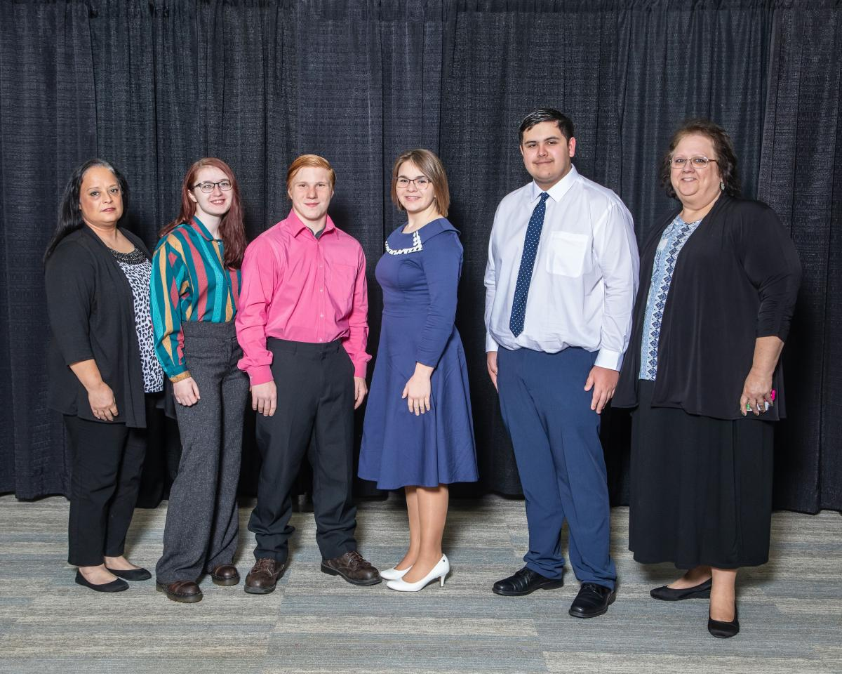 Lu Phillips (right) pictured with the Avian Quiz Bowl Team.