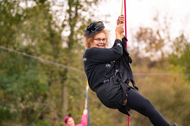 A woman ziplining.