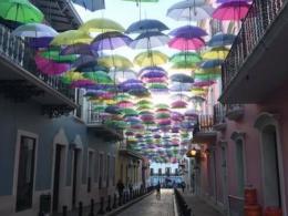 colorful umbrellas over a brick street in Puerto Rico