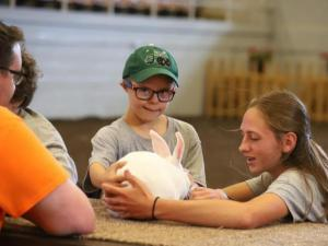 Youth holding a rabbit.