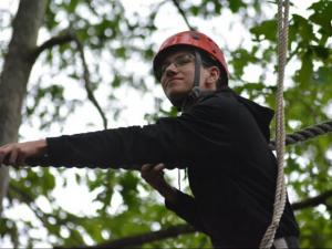 Matthew Swearingen participating in high ropes activities.