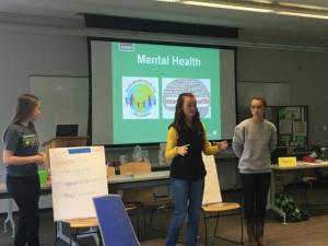 (left to right) Piper Brill, Madelyn Smith, and Ivy Smith, all from Franklin County, lead an activity they developed to raise awareness about mental health stigma and ways mental health can be addressed at the individual, group, organizational, and policy levels.