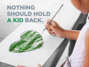 """A child painting a green heart. Text on the photo reads """"Nothing should hold a kid back."""""""