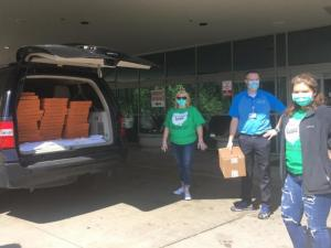 The Indian Clover Tribe 4-H Club donating 40 pizzas to staff at Southern Ohio Medical Center.