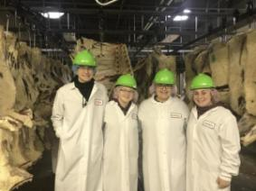 Four youth 4-H'ers at a meat processing facility.