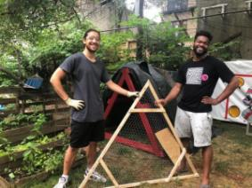 Eric Tiu and Jameel Watson with their chicken coop.