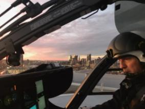 Jeff piloting a helicopter.