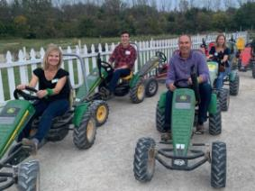 A group of 4-H supporters on pedal carts at Leeds Farm.