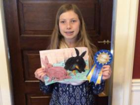 Olivia with the blue ribbon Jean mailed her.