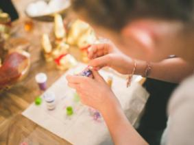 A girl working on a craft project.