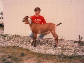 Young Kirk Bloir with a dairy goat.